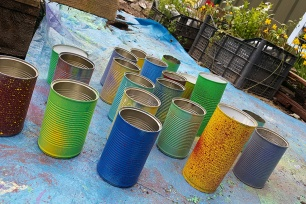 Tins upcycled into colorful flowerpots